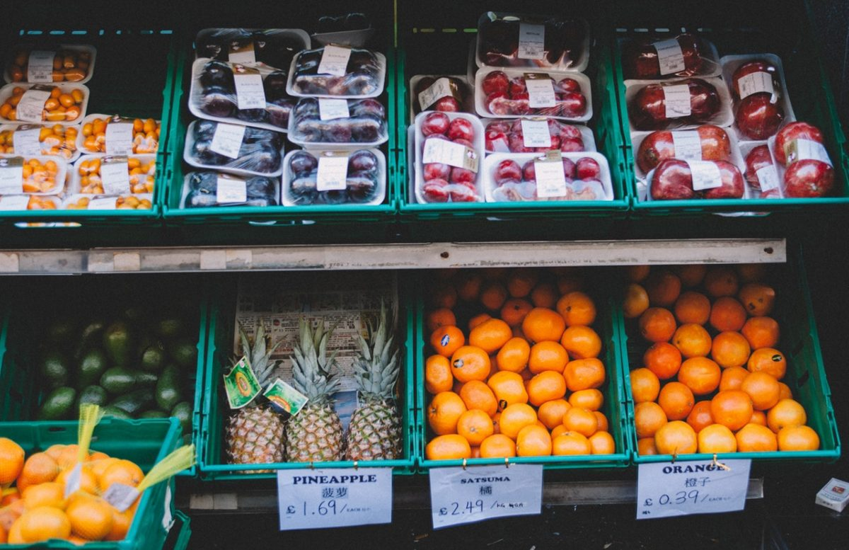 assorted fruits on shelves