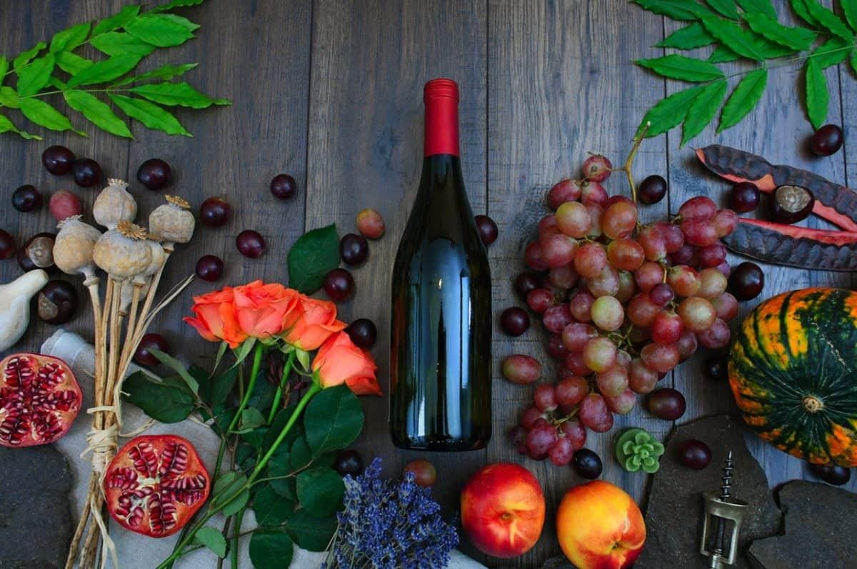 bottled apple cider vinegar near fruits and vegetables
