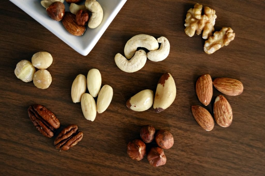 a variety of nuts on a surface
