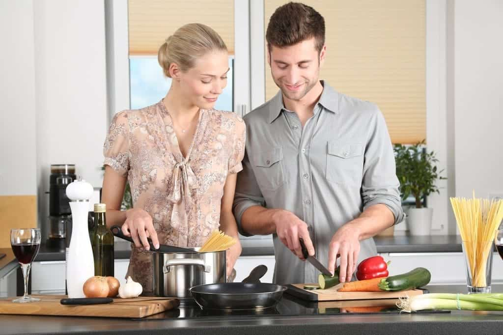 man and woman in a kitchen