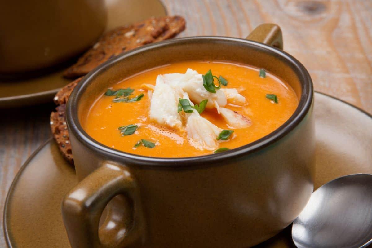 Creamy crab soup in bowl mug