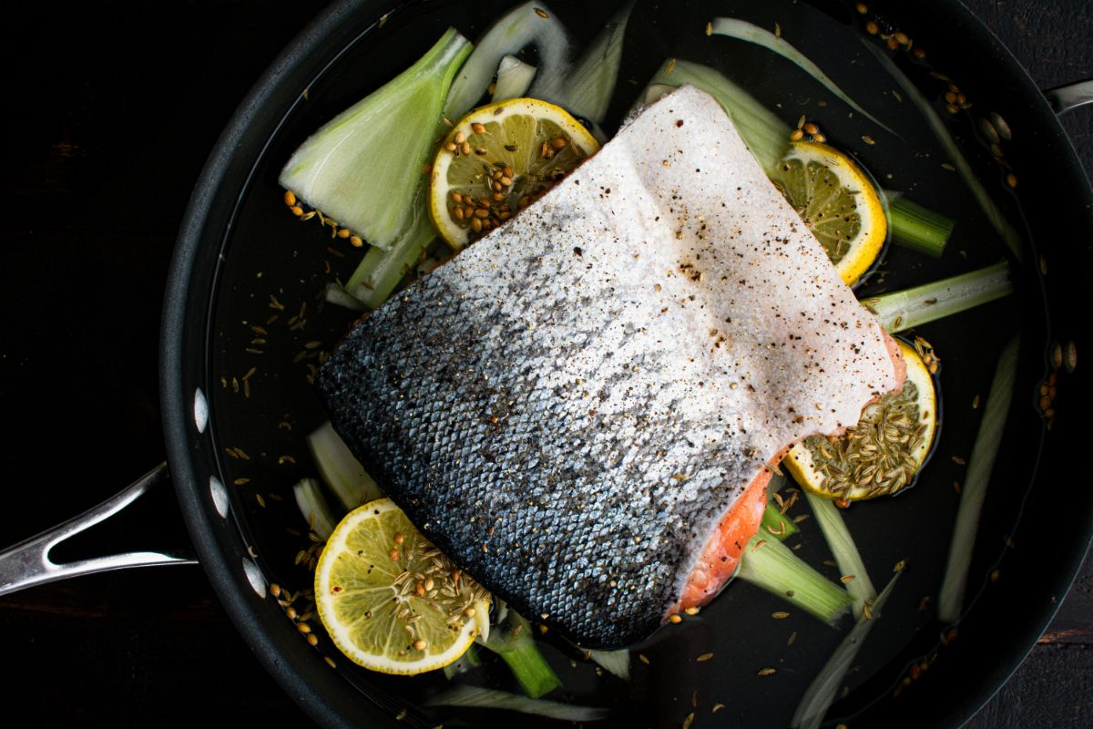 Poached salmon in water