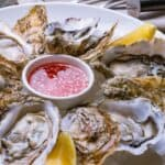 plated oyster with mignonette sauce